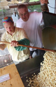 Poppin' Joe stirs his kettle corn.