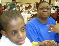 Mom and son enjoyng dinner at a Topeka Family Enrichment Weekend